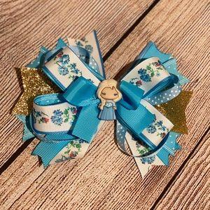 2 Frozen theme handmade hair bows.
